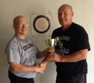 Dean Ross (right) recieving the 2015 Presidential Cup from Denny Habecker (left).