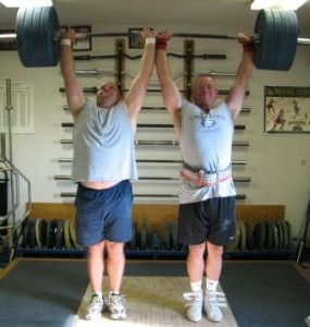 8 time USAWA Team Champions Chad Ullom and Al Myers performing a 430 pound Heels Together Clean and Press in the first USAWA Team Championships in 2007.