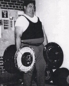 This picture of Joe McCoy performing a two dumbbell deadlift is in the USAWA Rulebook.
