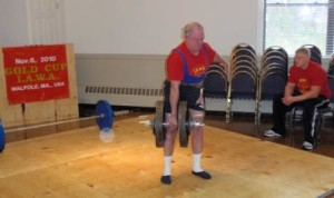 John McKean performing a One Arm Dumbbell Deadlift at the 2010 IAWA Gold Cup in Boston.