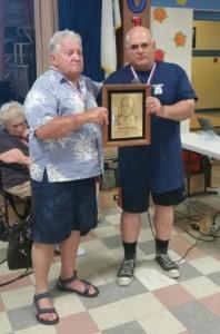 Bob Geib (left) presenting the Howard Prechtel Memorial Plaque to Nationals meet promoter Frank Ciavattone (right).