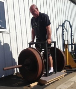 Peter Phillips lifting the 1500 pound challenge train wheels at the Dino Gym.