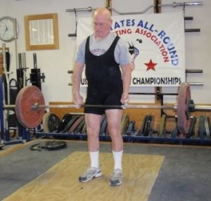 Our USAWA President Denny Habecker getting getting a good stretch on his middle fingers doing the Middle Fingers Deadlift at the 2011 Grip Championships.