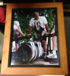 This picture of Frank doing a heavy Harness Lift hangs on the wall of Frank's Barbell Club. I took a picture of it the last time I was at his gym because it answers a basis question. What do you do when you lift so much the bar isn't big enough? Well - you tape on more!!!