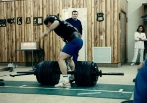 Tom Ryan watching as Barry Bryan does a 1500 pound Hip Lift at a meet in John Vernacchio's Gym in 1989.