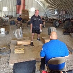 Greg Cook performing a 755 pound Kennedy Lift.