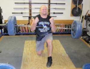 Chad Ullom performing the top Scott Lift of All Time in the USAWA, at the 2010 Dino Gym Record Day.