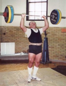 Jim Malloy performing a clean and press with heels together.